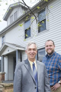 Bryan Toney, left, associate vice chancellor for economic development and corporate engagement at UNCG, and Justin Streuli, director of the N.C. Entrepreneurship Center at UNCG, stand in front of the house on Silver Avenue in Greensboro that will be renovated for ThinkHouseU. Photo for TBJ by Julie Knight