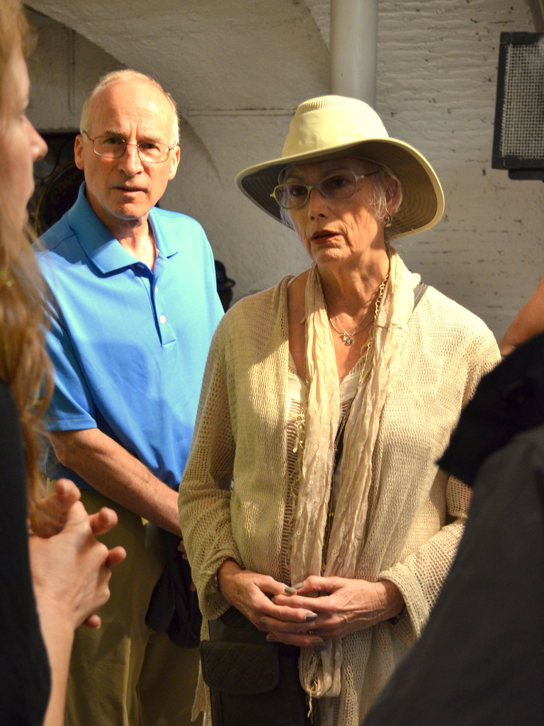 Emmylou listens as JRS officials explain the plight of EU refugees. Photo by Justin Catanoso
