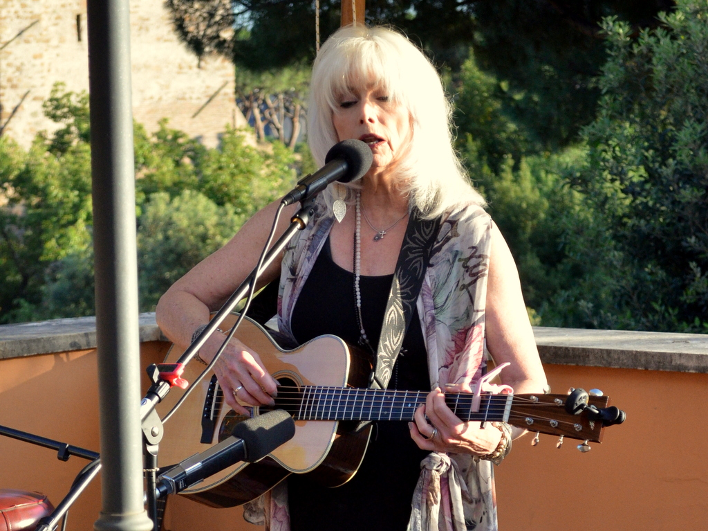 Emmylou Harris performing at at private concert on June 2 at the residence of David Lane, US ambassador to UN Agencies.