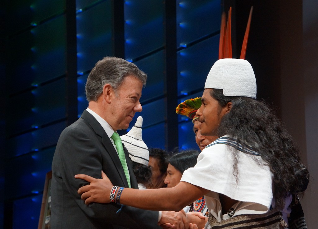 President Santos greets indigenous leaders from Colombia on stage at the conclusion of the event at National Geographic headquarters in Washington, DC. Photo by Enrique Ortiz